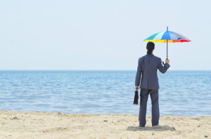Man with umbrella on beach